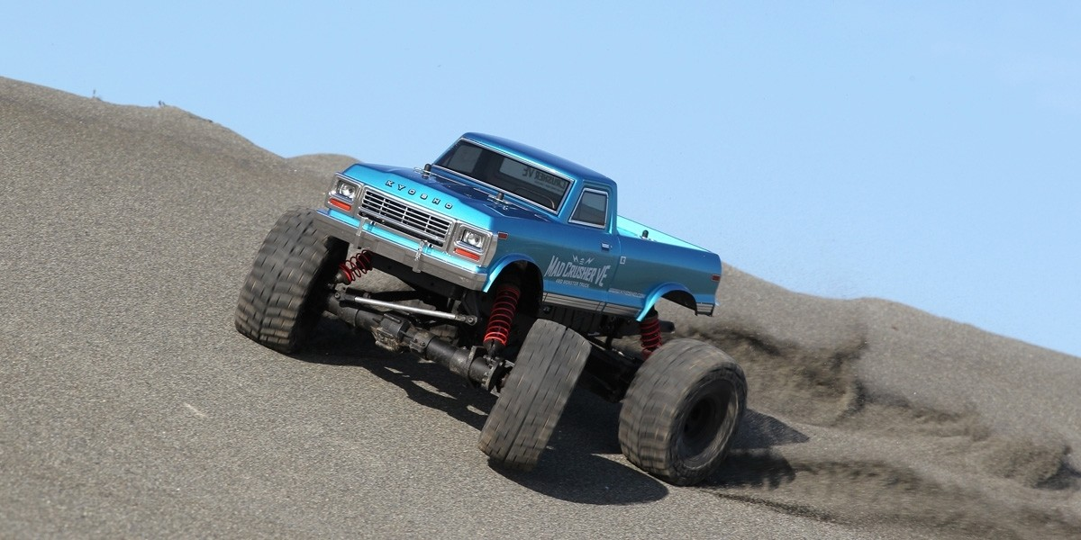 PACK Kyosho Truck 1/8 MAD CRUSHER VE BRUSHLESS LIPO 4S + CHARGEUR